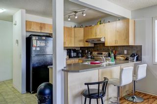 Photo 5: 388 Panatella Boulevard NW in Calgary: Panorama Hills Row/Townhouse for sale : MLS®# A1114400
