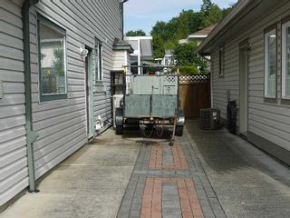 """Photo 33: 4140 GOODCHILD Street in Abbotsford: Abbotsford East House for sale in """"Hollyhock"""" : MLS®# R2587855"""
