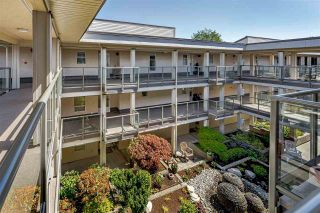 """Photo 1: 304 15255 18 Avenue in Surrey: King George Corridor Condo for sale in """"The Courtyards"""" (South Surrey White Rock)  : MLS®# R2574709"""