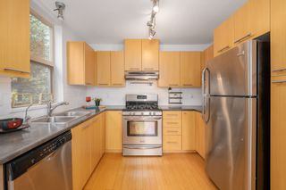 """Photo 8: 404 9339 UNIVERSITY Crescent in Burnaby: Simon Fraser Univer. Condo for sale in """"HARMONY AT THE HIGHLANDS"""" (Burnaby North)  : MLS®# R2578073"""