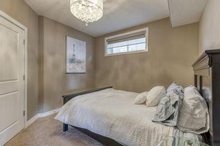 Photo 35: 43 Sunset Way: Cochrane Detached for sale : MLS®# A1071186