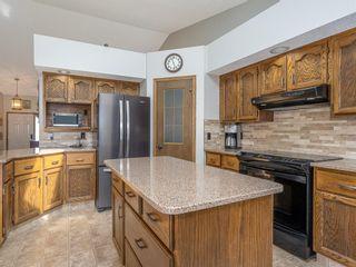 Photo 10: 107 Hawktree Bay NW in Calgary: Hawkwood Detached for sale : MLS®# A1113635