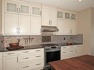 Photo 6: 169 KINGSBRIDGE Way SE: Airdrie House for sale : MLS®# C4111367