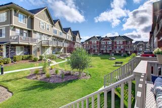 Photo 9: 1103 125 Panatella Way NW in Calgary: Panorama Hills Row/Townhouse for sale : MLS®# A1143179