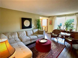 """Photo 3: 104 3921 CARRIGAN Court in Burnaby: Government Road Condo for sale in """"LOUGHEED ESTATES"""" (Burnaby North)  : MLS®# R2540449"""