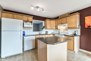 Photo 11: 6 Crystal Shores Cove: Okotoks Row/Townhouse for sale : MLS®# A1080376