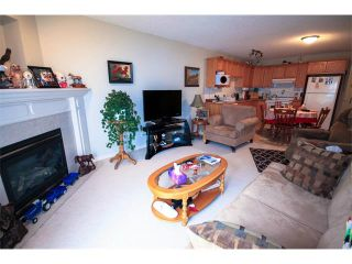 Photo 5: 2 117 BOW RIDGE Drive: Cochrane House for sale : MLS®# C4003118