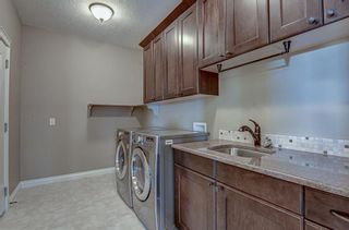 Photo 17: 72 Elysian Crescent SW in Calgary: Springbank Hill Semi Detached for sale : MLS®# A1148526