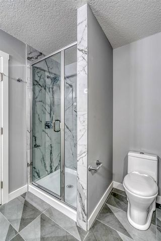 Photo 17: 4302 Bowness Road NW in Calgary: Montgomery Row/Townhouse for sale : MLS®# A1148589