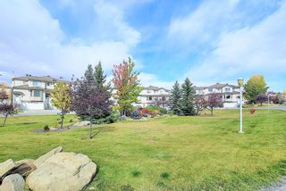 Photo 3: 121 Country Hills Gardens NW in Calgary: Country Hills Row/Townhouse for sale : MLS®# A1057496
