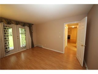 """Photo 9: 105 515 WHITING Way in Coquitlam: Coquitlam West Condo for sale in """"Brookside Manor"""" : MLS®# V903579"""