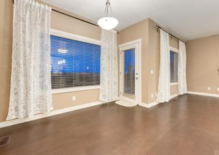 Photo 14: 150 AUTUMN Circle SE in Calgary: Auburn Bay Detached for sale : MLS®# A1089231