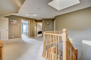 Photo 18: 39 Slopes Grove SW in Calgary: Springbank Hill Detached for sale : MLS®# A1110311