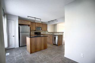 Photo 7: 23 Auburn Bay Common SE in Calgary: Auburn Bay Row/Townhouse for sale : MLS®# A1043994