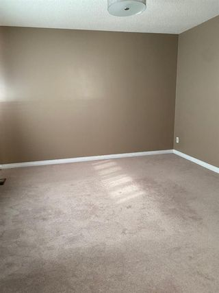 Photo 16: 554 STRATHCONA Drive SW in Calgary: Strathcona Park Semi Detached for sale : MLS®# A1020759