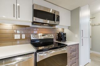 """Photo 5: 102 1450 PENNYFARTHING Drive in Vancouver: False Creek Condo for sale in """"Harbour Cove"""" (Vancouver West)  : MLS®# R2560607"""