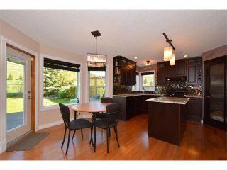 Photo 4: 148 GLENEAGLES Close: Cochrane House for sale : MLS®# C4010996