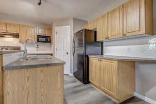 Photo 12: 52 COUGARSTONE Villa SW in Calgary: Cougar Ridge Detached for sale : MLS®# A1020063