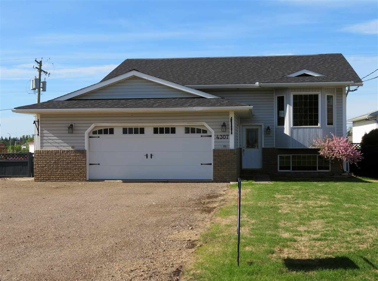 Main Photo: 4305 E 51 Avenue in Fort Nelson: Fort Nelson -Town House for sale (Fort Nelson (Zone 64))  : MLS®# R2524123