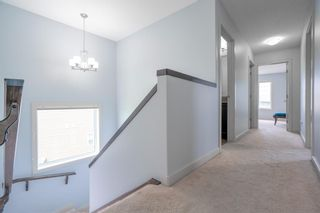 Photo 12: 70 Everhollow Green SW in Calgary: Evergreen Detached for sale : MLS®# A1131033