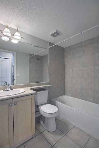 Photo 31: 7402 304 MacKenzie Way SW: Airdrie Apartment for sale : MLS®# A1081028