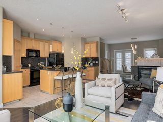 Photo 10: 81 Somme Boulevard SW in Calgary: Garrison Woods Residential for sale : MLS®# A1072185