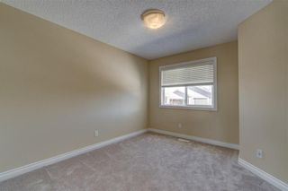 Photo 41: 204 SUNTERRA Boulevard: Cochrane House for sale : MLS®# C4164735