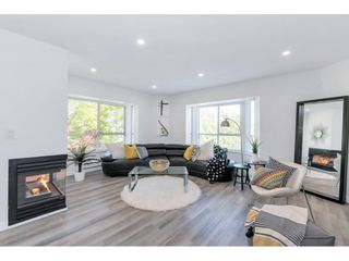 """Photo 1: 325 1952 152A Street in Surrey: King George Corridor Condo for sale in """"Chateau Grace"""" (South Surrey White Rock)  : MLS®# R2580670"""