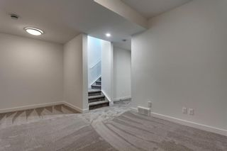 Photo 36: 1940 Bowness Road NW in Calgary: West Hillhurst Semi Detached for sale : MLS®# A1146767