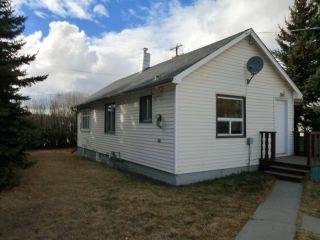 Photo 3: 204 CENTRE Avenue: Cochrane House for sale : MLS®# C4055784