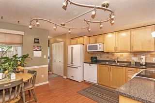 "Photo 7: 105 7837 120A Street in Surrey: West Newton Townhouse for sale in ""Berkshyre Gardens"" : MLS®# R2371000"