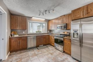 Photo 8: 11 Range Way NW in Calgary: Ranchlands Detached for sale : MLS®# A1088118