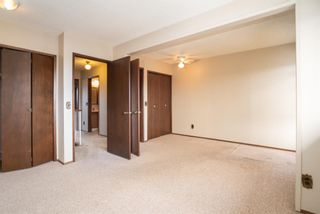 Photo 19: 5 903 67 Avenue SW in Calgary: Kingsland Row/Townhouse for sale : MLS®# A1079413