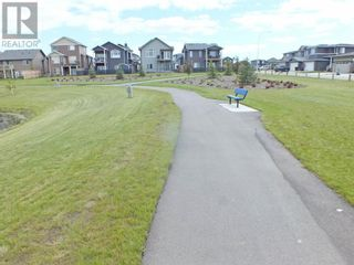 Photo 32: 504 Greywolf Cove N in Lethbridge: House for sale : MLS®# A1153214