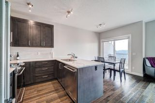 Photo 10: 907 Jumping Pound Common: Cochrane Row/Townhouse for sale : MLS®# A1132952
