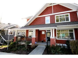"""Photo 1: 104 6878 SOUTHPOINT Drive in Burnaby: South Slope Townhouse for sale in """"CORTINA"""" (Burnaby South)  : MLS®# V878295"""