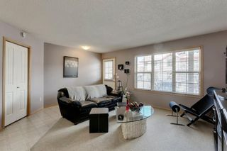 Photo 4: 104 3 EVERRIDGE Square SW in Calgary: Evergreen Row/Townhouse for sale : MLS®# A1143635