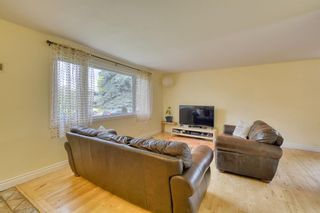Photo 16: 212 Queen Alexandra Road SE in Calgary: Queensland Detached for sale : MLS®# A1118884