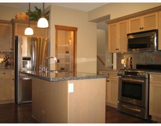 "Photo 2: 67 24185 106B Avenue in Maple Ridge: Albion Townhouse for sale in ""TRAILS EDGE"" : MLS®# V778993"