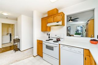 """Photo 11: 312 5710 201 Street in Langley: Langley City Condo for sale in """"WHITE OAKS"""" : MLS®# R2387162"""