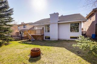 Photo 24: 24 SIGNATURE Way SW in Calgary: Signal Hill Detached for sale : MLS®# C4302567