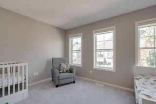 Photo 19: 111 Ascot Point SW in Calgary: Aspen Woods Row/Townhouse for sale : MLS®# A1144877