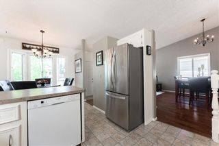 Photo 9: 144 RIVERBROOK Road SE in Calgary: Riverbend Detached for sale : MLS®# C4305996
