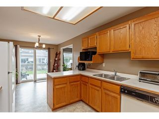 """Photo 10: 103 5641 201 Street in Langley: Langley City Townhouse for sale in """"THE HUNTINGTON"""" : MLS®# R2537246"""
