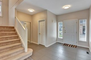 Photo 2: 37 1751 PADDOCK Drive in Coquitlam: Westwood Plateau Townhouse for sale : MLS®# R2579249