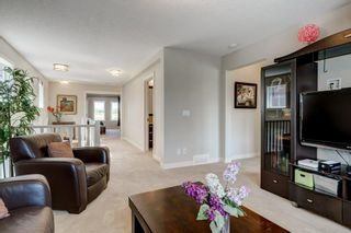 Photo 8: 168 ASCOT CR SW in Calgary: Aspen Woods House for sale : MLS®# C4268023