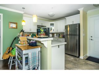 """Photo 6: 407 8084 120A Street in Langley: Queen Mary Park Surrey Condo for sale in """"Eclipse"""" (Surrey)  : MLS®# R2333868"""