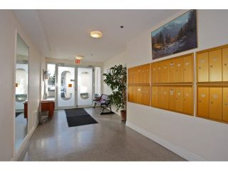 "Photo 16: 311 5955 177B Street in Surrey: Cloverdale BC Condo for sale in ""WINDSOR PLACE"" (Cloverdale)  : MLS®# F1433073"