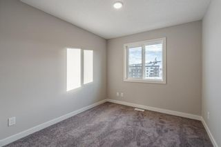 Photo 22: 309 81 Greenbriar Place NW in Calgary: Greenwood/Greenbriar Row/Townhouse for sale : MLS®# A1058995