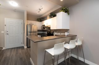 """Photo 11: 418 20200 56 Avenue in Langley: Langley City Condo for sale in """"The Bentley"""" : MLS®# R2612612"""